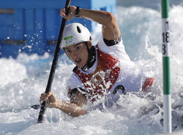 Maialen Chourraut of Spain paddles on her way to winning the gold in the kayak K1 women's canoe slalom at the 2016 Summer Olympics in Rio de Janeiro, Brazil, Thursday, Aug. 11, 2016. (AP Photo/Robert F. Bukaty)